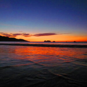 Sunset playa Hermosa with the moon following close behind